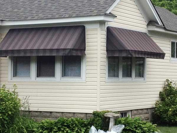 brown striped fixed frame awnings